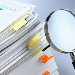 25828465 - investigate and analyze  magnifying glass and stack of documents