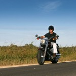 3758495 - a man cruises on a classic style motorbike