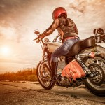 35796826 - biker girl in a leather jacket and helmet on a motorcycle