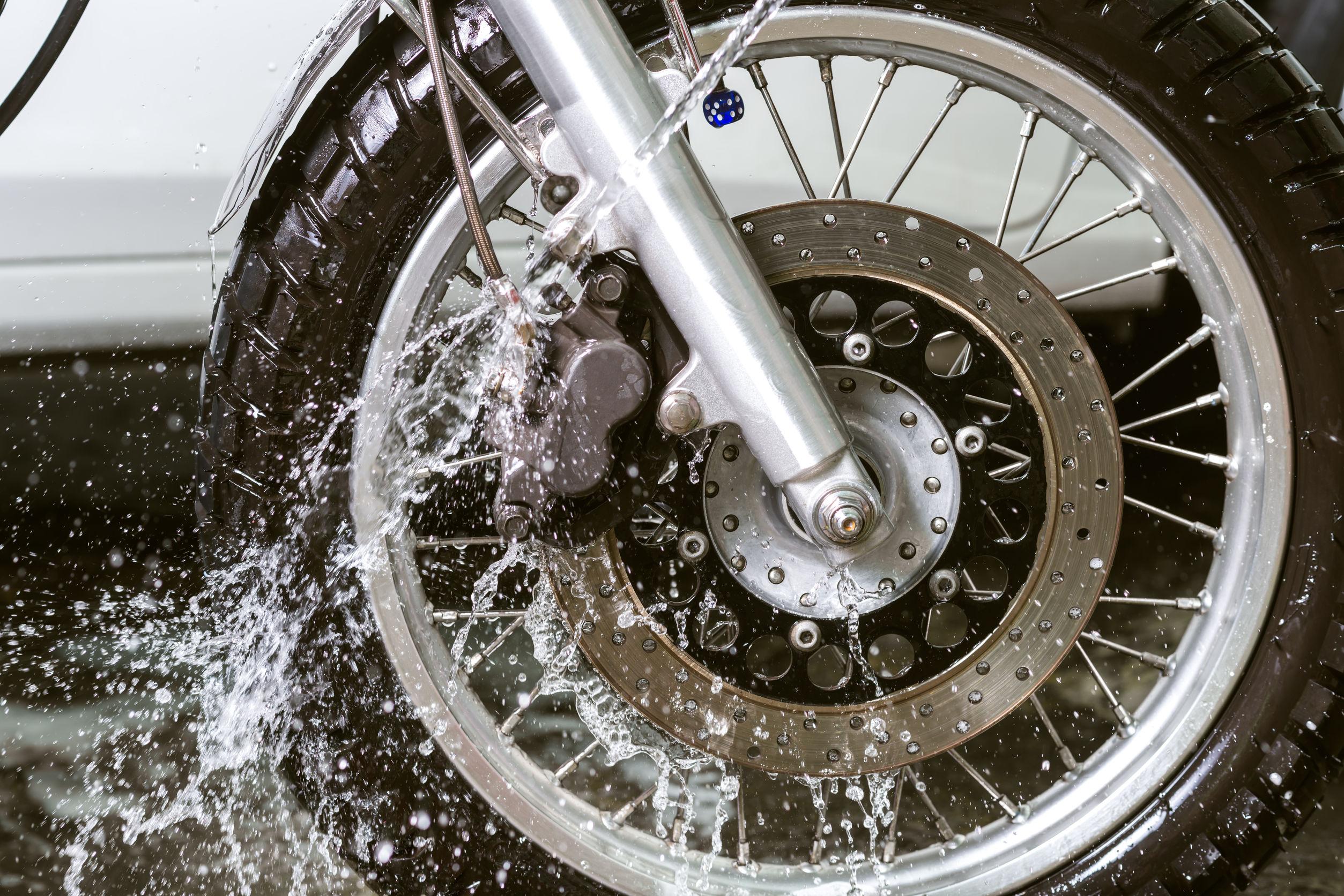 55575104 - motorbike washing series : wash motocycle wheel