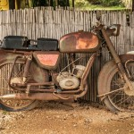 24567201 - the old, rusty motorcycle on a street