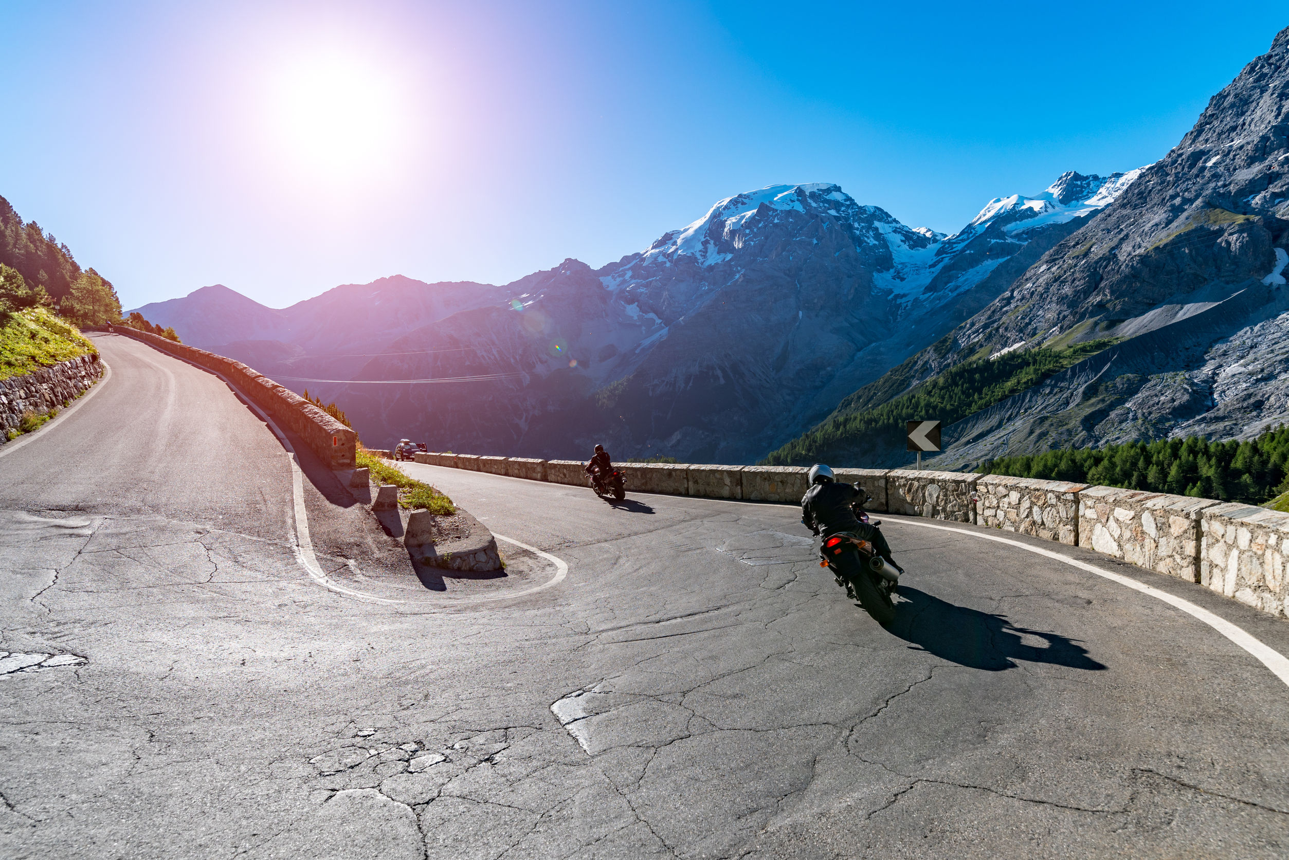 64630927 - beautiful sunset above the motorbike on the famous road in mountains alps passo stelvio