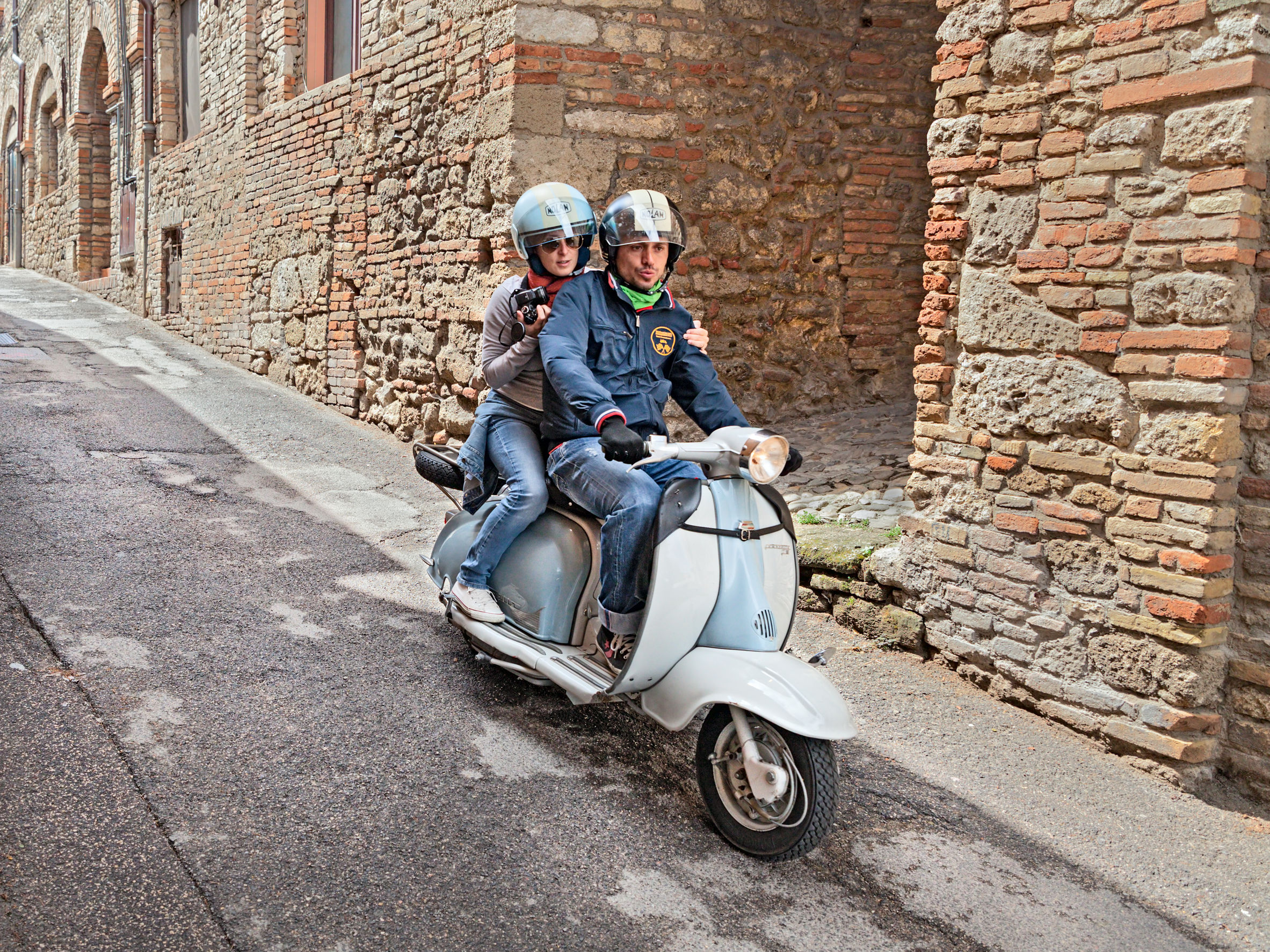"29851802 - bertinoro (fc) italy - june 14: a couple riding a vintage scooter lambretta during the italian scooters rally ""innocenti day"" of lambretta club umbria, on june 14, 2014 in bertinoro (fc) italy"