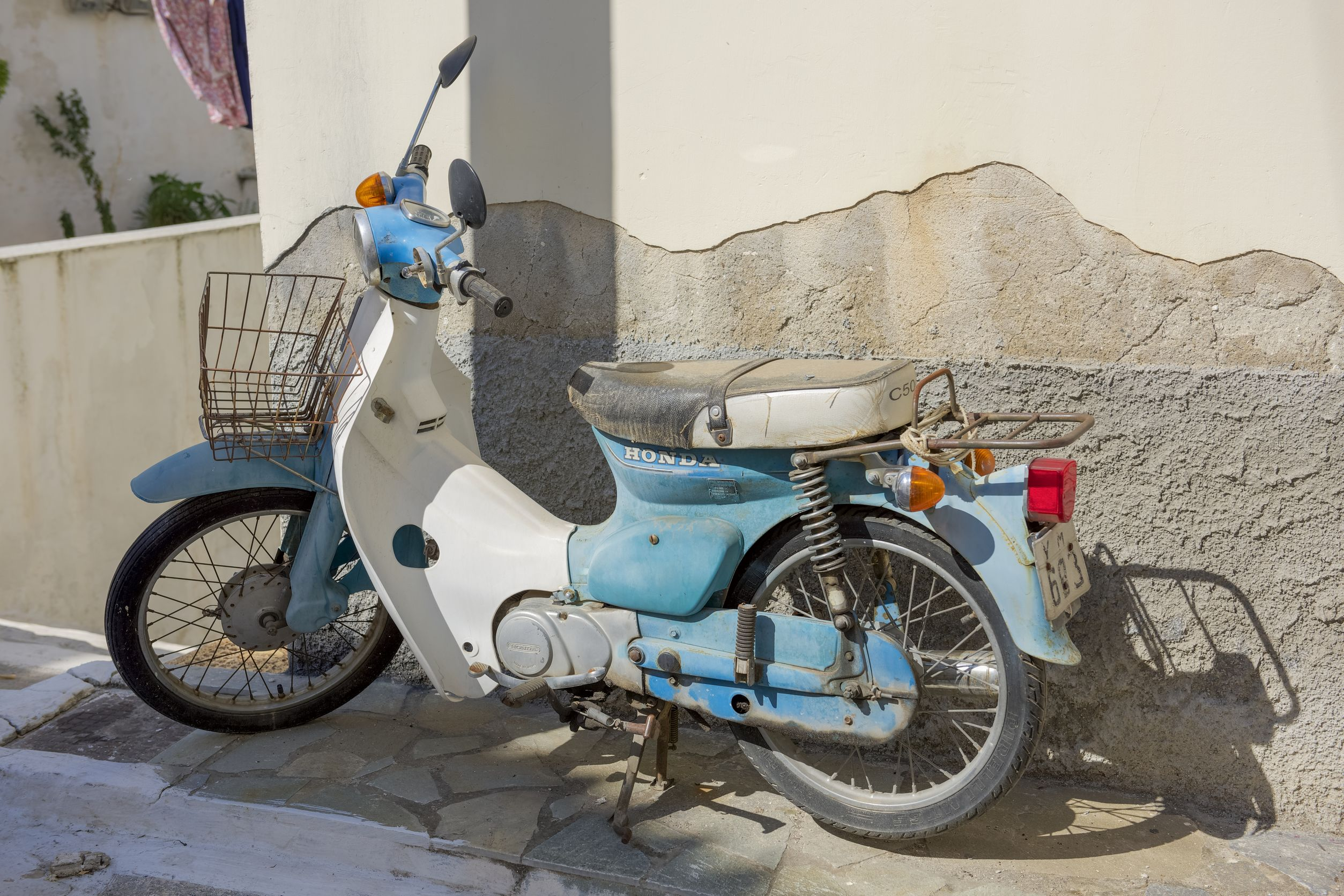38714194 - poros, greece - september 27, 2014: old honda parked on old street in poros island, greece.