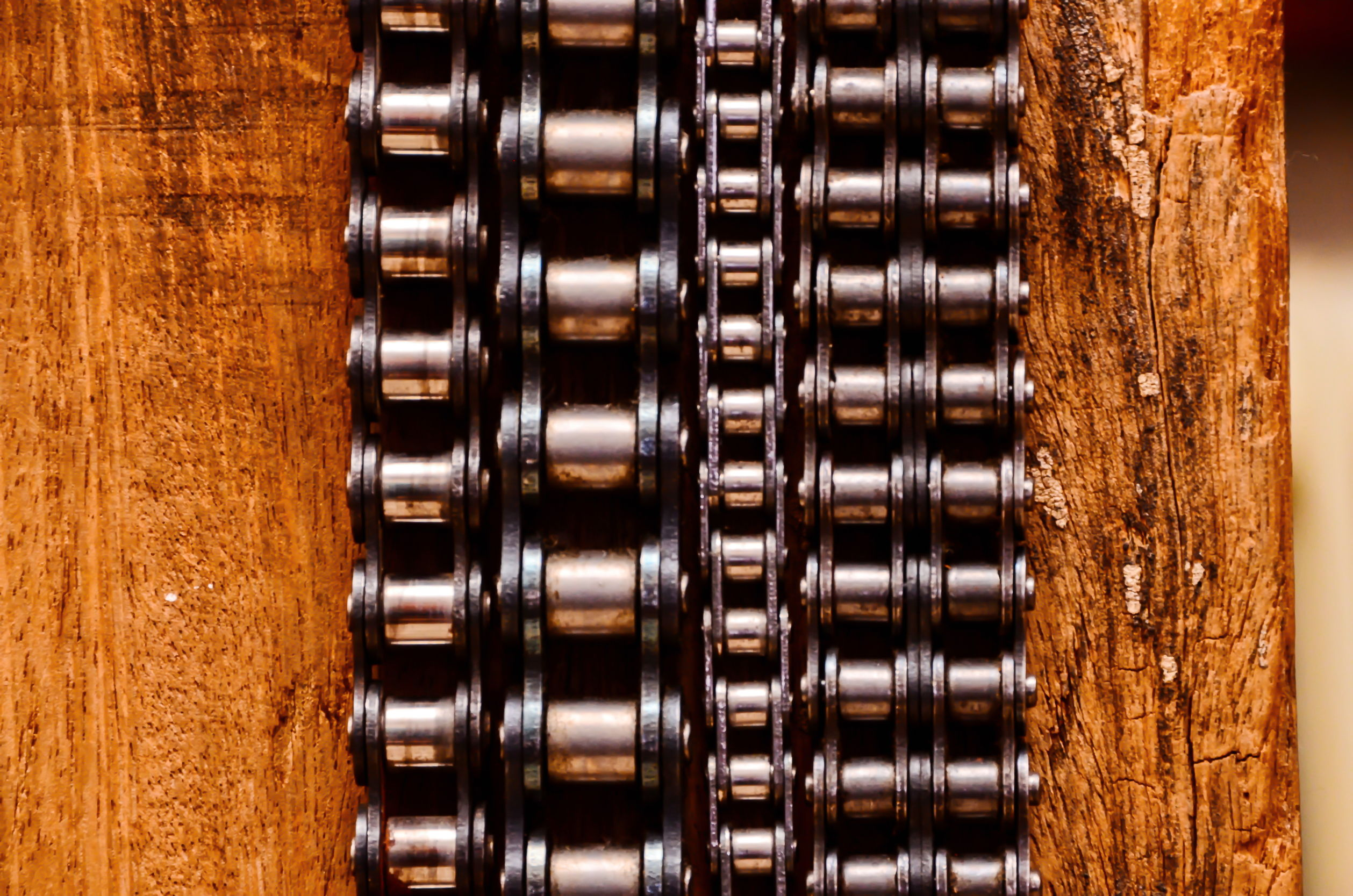 54273790 - part of a used automotive gear chain n a wooden background