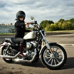 10842527 - biker girl sits on a motorcycle