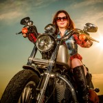 20401964 - biker girl with sunglasses sitting on motorcycle