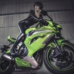 Freedom,  brunette woman wearing latex mounted on a motorcycle with a modern design