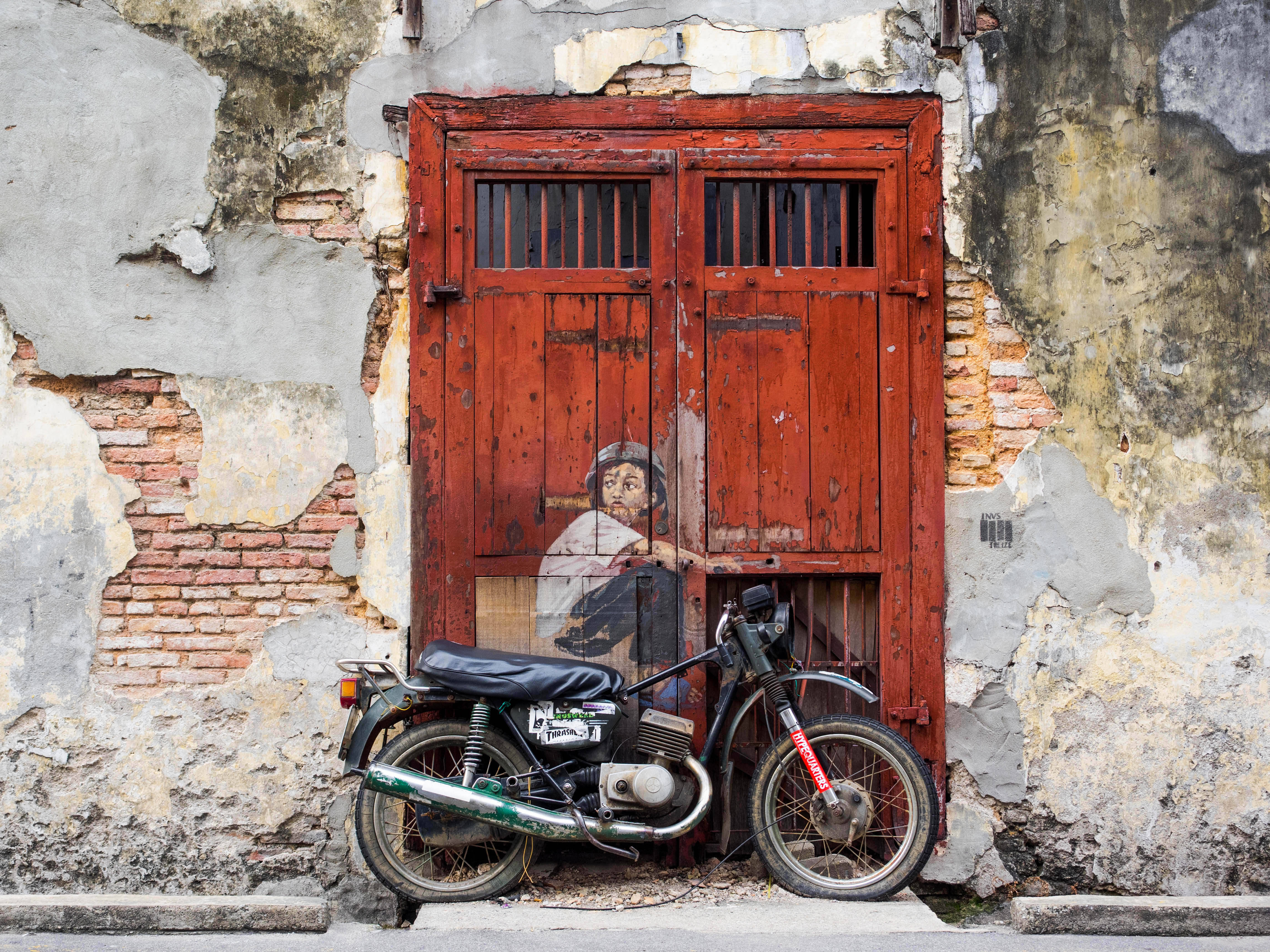 "George Town, Penang, Malaysia - April 23, 2014: ""Boy on a Bike"" street art mural by Lithuanian artist Ernest Zacharevic in George Town, Penang, Malaysia."