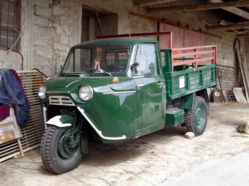 58553404 - three-wheeled truck at the wall of the village house